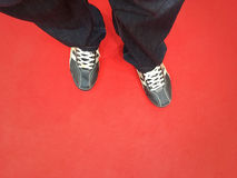 Red carpet. Close up of a man's feet on the red carpet. Red carpet welcome concept Stock Image