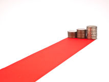 Red carpet and coin. Red carpet and column of coin isolated on white background Royalty Free Stock Photo