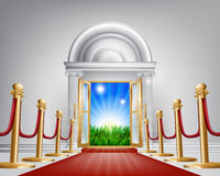 Red carpet door to your future. A red carpet grand luxury entrance door leading into a perfect idyllic green field landscape with sunrise. Represents a fresh Stock Photography