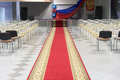 Red carpet in an empty auditorium. Royalty Free Stock Photo