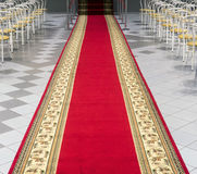Red carpet in an empty auditorium. Stock Image