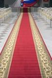 Red carpet in an empty auditorium. Stock Photos