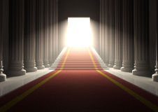 Red carpet entrance. 3D entrance with a red carpet and columns  with stairs and a shining exit door Stock Image