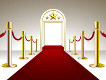 Red Carpet Entrance. Vector illustration representing luxury red carpet with entrance ornate with golden stars above Royalty Free Stock Photography