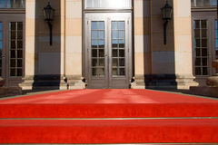 Red carpet and entrance door. A red carpet leading to an entrance door Royalty Free Stock Photos