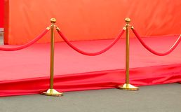 Red carpet entrance with golden stanchions and ropes. Celebrity nominees to premiere. Stars on the festive awarding of prizes Royalty Free Stock Photos