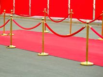 Red carpet entrance with golden stanchions and ropes. Celebrity nominees to premiere. Stars on the festive awarding of prizes Royalty Free Stock Photography