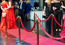 Red carpet entrance with stanchions and ropes Stock Photo