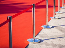 Red Carpet fence pole Red ropes Fashion show Event. Red Carpet fence pole with red ropes Fashion show Event Concept Stock Photography