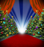 Red Carpet Holidays. With curtains and Christmas trees with decorative ornaments for a Hollywood winter season premier and grand opening movie celebration and Royalty Free Stock Images