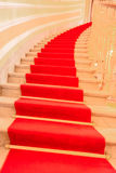 Red carpet interior stairs. Architectural image inside of a luxury building with the red carpet stairs Royalty Free Stock Image