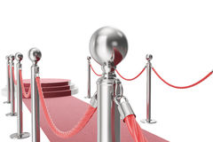 Red carpet isolated on white background. 3d rendering of silver stanchions and ropes between them Royalty Free Stock Photos
