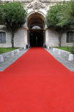 Celebrity VIP red carpet, hotel theater entrance doorway, copy space, vertical Royalty Free Stock Photo