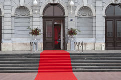 Red carpet. Laid on the stairs for the ceremony Stock Photo