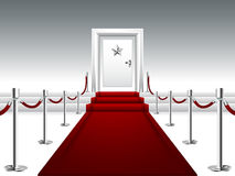 Red Carpet Leading to the Door with Silver Star Stock Photo