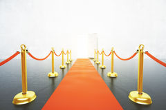 Red carpet leading to open door concept Stock Image