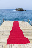 Red carpet leading to the sea Stock Photo