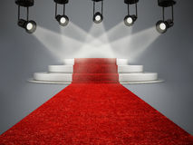 Red carpet leading to the stage illuminated by spotlights Stock Photography