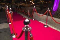 Red carpet. Long red carpet between rope barriers on VIP entrance Stock Photography