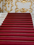 Red carpet on the marble staircase Stock Photo