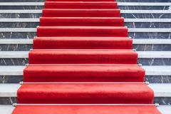 Red carpet on the marble staircase. Real photo of Red carpet on the marble staircase Royalty Free Stock Images