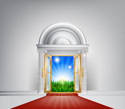 Red carpet nature door. A grand entrance door with red carpet leading to it opening onto a beautiful dawn over a green field Royalty Free Stock Images