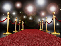 Red carpet at night with flashlights Stock Image