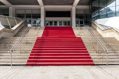 Red carpet over stairs Royalty Free Stock Images
