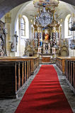 Red carpet in the praying hall. Red carpet is placed in the praying hall of church Stock Photos