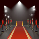 Red carpet with red ropes Royalty Free Stock Photography