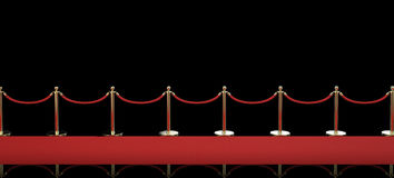 Red carpet with rope barrier on black background Stock Photos