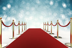 Red carpet with rope barrier on blue background Stock Images