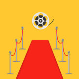 Red carpet and rope barrier golden stanchions turnstile Movie premiere Cinema reel. Isolated template Yellow background. Flat desi Stock Photography