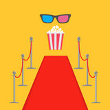Red carpet and rope barrier golden stanchions turnstile Popcorn box. Royalty Free Stock Photo
