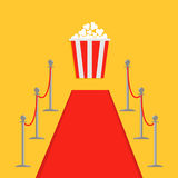 Red carpet and rope barrier golden stanchions turnstile Popcorn box.  template Yellow background. Flat design Royalty Free Stock Photography