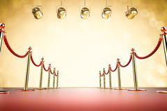 Red carpet and rope barrier with shining spotlights Royalty Free Stock Images
