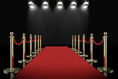 Red carpet and rope barrier with shining spotlights. 3d rendering red carpet and rope barrier with shining spotlights stock photography