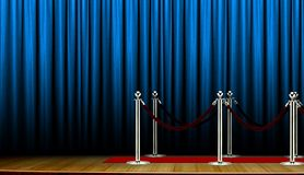 Red carpet on stage with blue curtain Royalty Free Stock Images