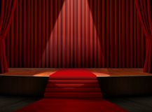 Red Carpet on Stage with Spotlight. With Red Curtains Stock Photography