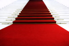 Red carpet on staircase Stock Images
