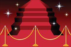 Red carpet on stairs. With line poles and stars Stock Image
