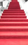 Red carpet on stairs Stock Photos