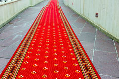 Red carpet on the stairs. Perspective Royalty Free Stock Photo