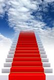 Red carpet on stairs to heaven Royalty Free Stock Images