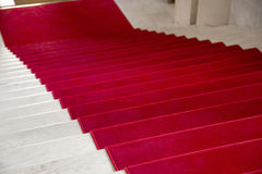 Red carpet. On a stairway used to mark the route on ceremonial and formal occasions or events Stock Photography