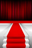 Red carpet on stairways and podium with curtain Stock Images