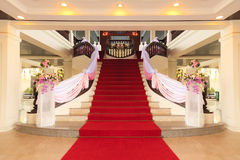 Red carpet on stone steps. Red carpet in the room for weddings stock image