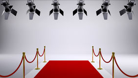Red carpet at the studio. On the ceiling are hanging lights Stock Photos