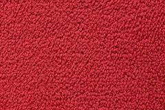Red carpet surface close up. royalty free stock image