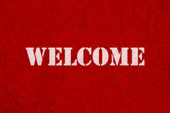 Red carpet and text ' welcome '. In white royalty free stock images